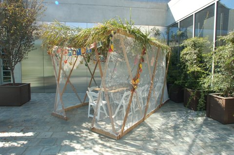 Skirball Cultural Center - Mid-size sukkah Table with 10 seats, Los Angeles, CA  (The schach is drooping, the top of the sukkah is straight.)