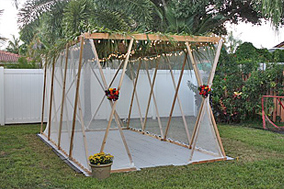Large sukkah seats 16 with 30-inch wide tables. (Floor provided by owner.)